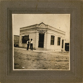 George Hayes visiting with a customer outside the original bank in Draper in 1913.